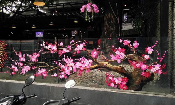 Mẫu trang trí tết hoa đào cho quán cafe